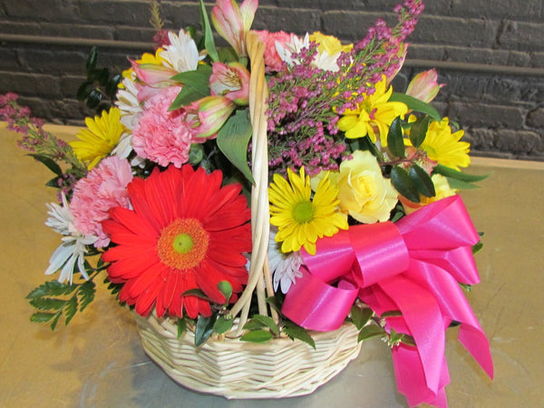 Basket full of bright colors with bows