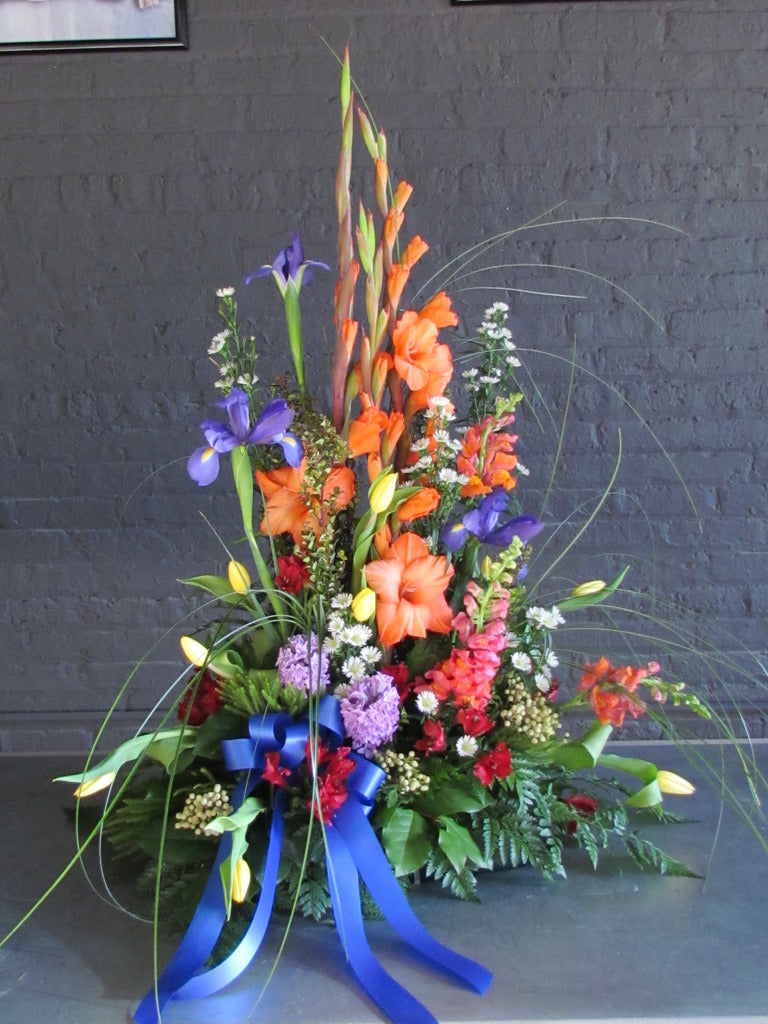 Beautiful tall and bright traditional funeral arrangement