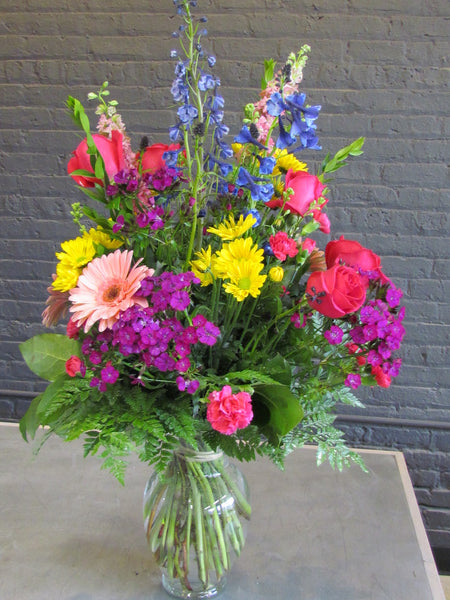 Large fresh bouquet arranged in glass vase