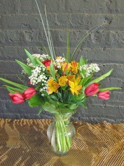 Spring flower bouquet in glass vase.