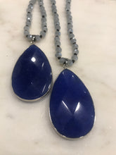 Load image into Gallery viewer, Blue pendant necklace on gray crystal bead