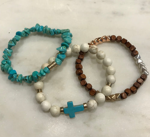 Three piece, cream howlite, turquoise, and wood set