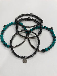 Five piece hematite and reconstituted turquoise with gunmetal bars