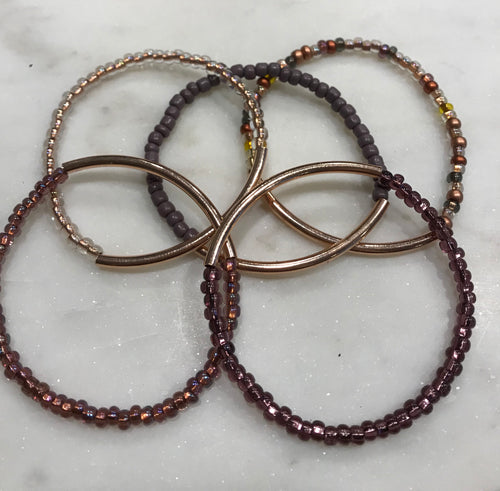 Five piece stack seed bead rose gold/purple set