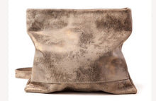 Convertible cross body bag to a clutch