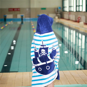Boys near pool wrapped in Hooded Pirate Ship Beach Towel