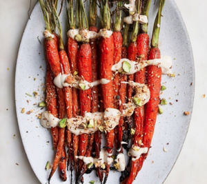 Roasted carrots sprinkled with Thank Fall Mutha Dukkah, a crunchy seasoning made with walnuts, roasted nuts, seeds, superfoods like coconut and cinnamon. A convenient vegan, gluten-free, seasoning mix sprinkled on sweet or savory dishes.
