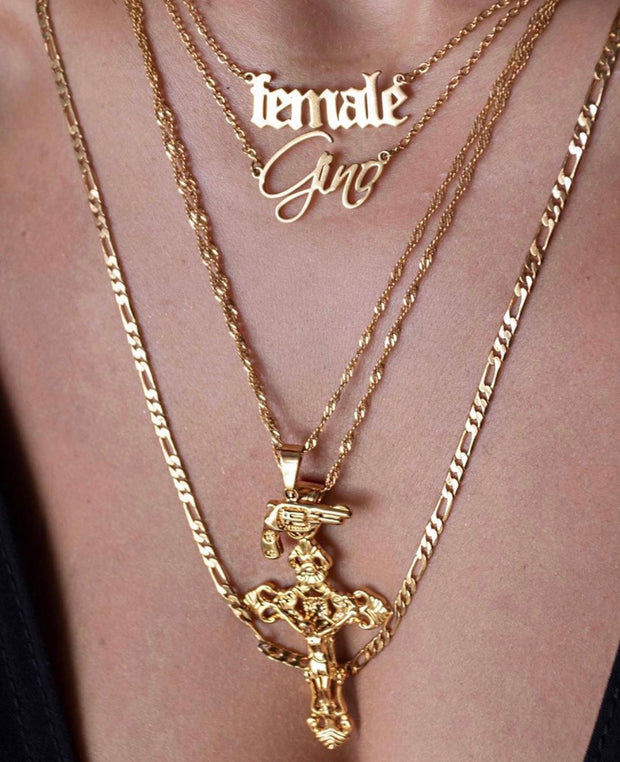 Classic gold pistol pendant necklace - medium worn