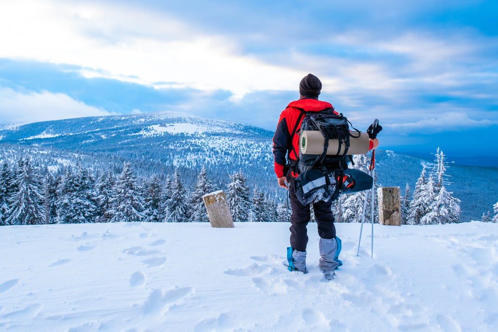man on top of a snowy mountain