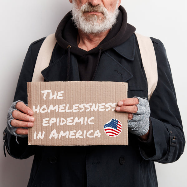 homeless man holding a sign