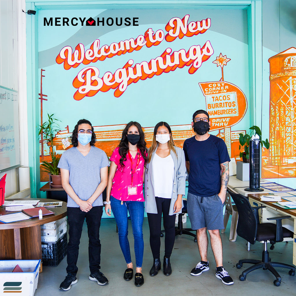 meriwool layers crew with the mercy house after a merino wool donation to the homeless