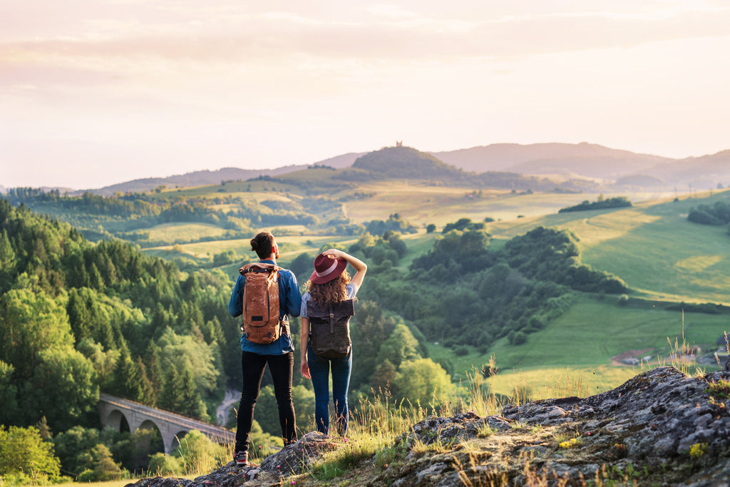 couple standing on a mountain top after a hike