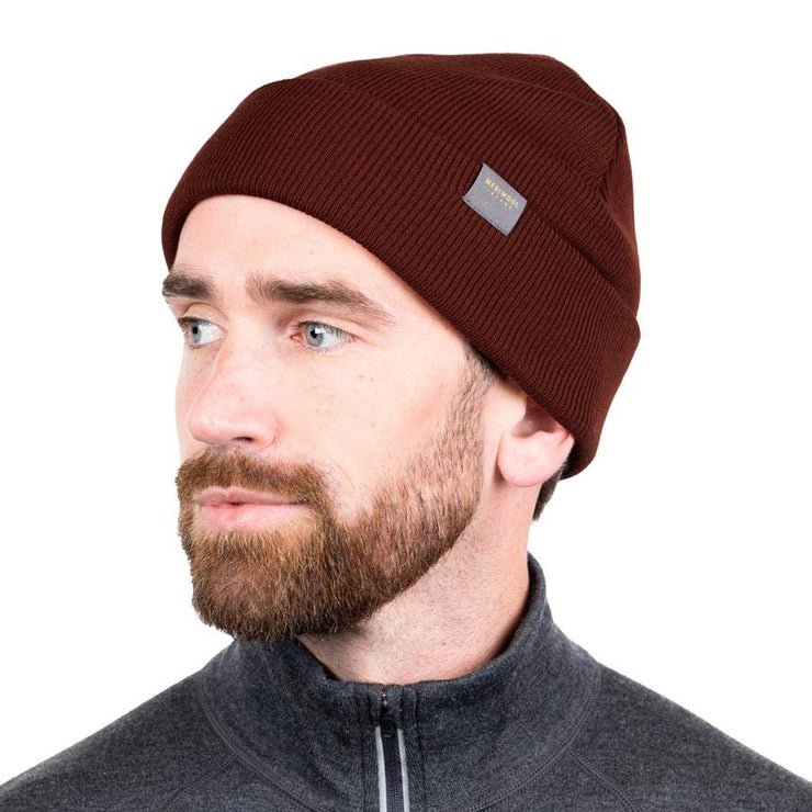 man wearing a wine colored merino wool ribbed knit beanie