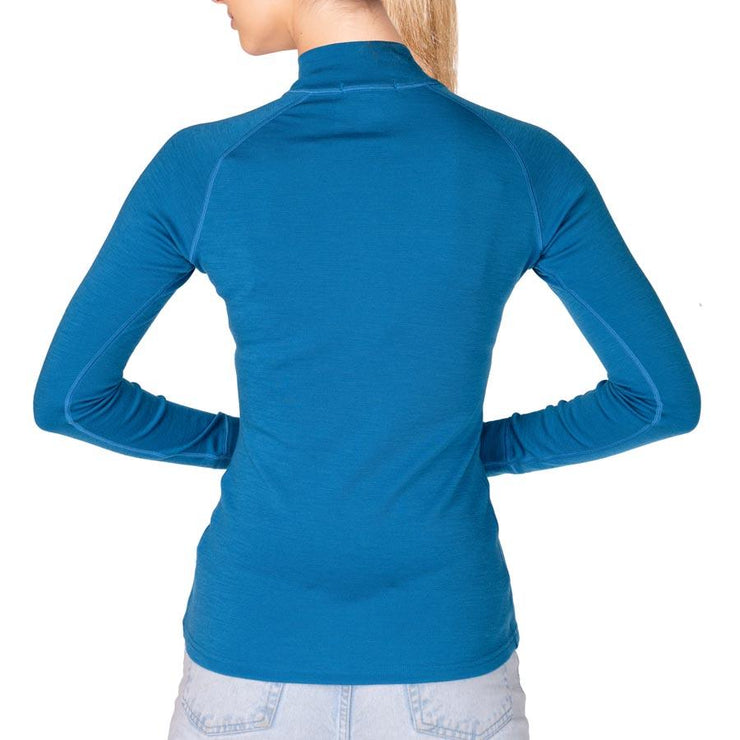 back of a woman wearing a women's electric blue merino wool 250 base layer half zip sweater