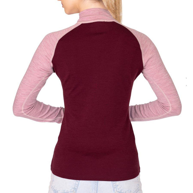 back of a woman wearing a women's wine and pink heather merino wool 250 base layer half zip sweater