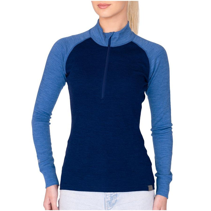 woman wearing a women's navy and sky blue heather merino wool 250 base layer half zip sweater