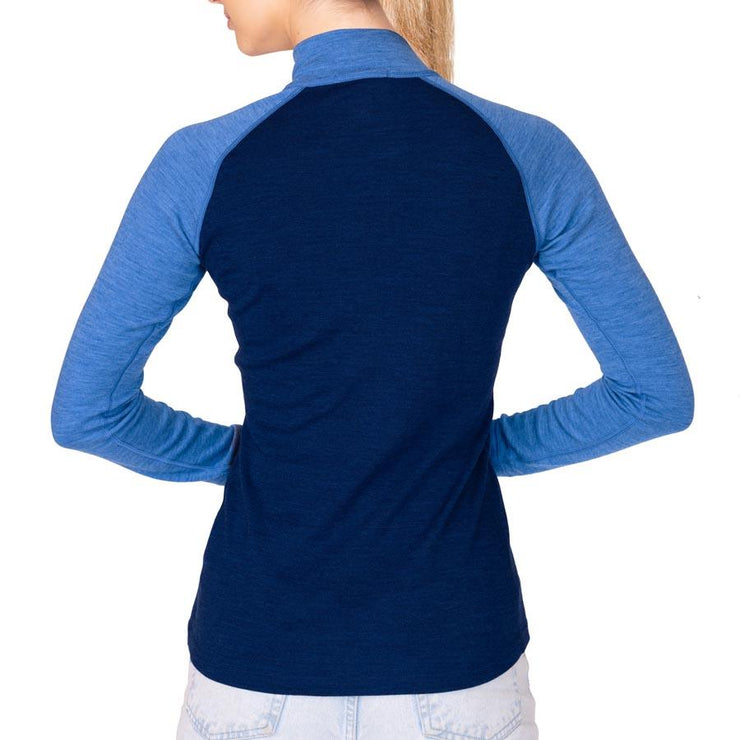 back of a woman wearing a women's navy and sky blue heather merino wool 250 base layer half zip sweater