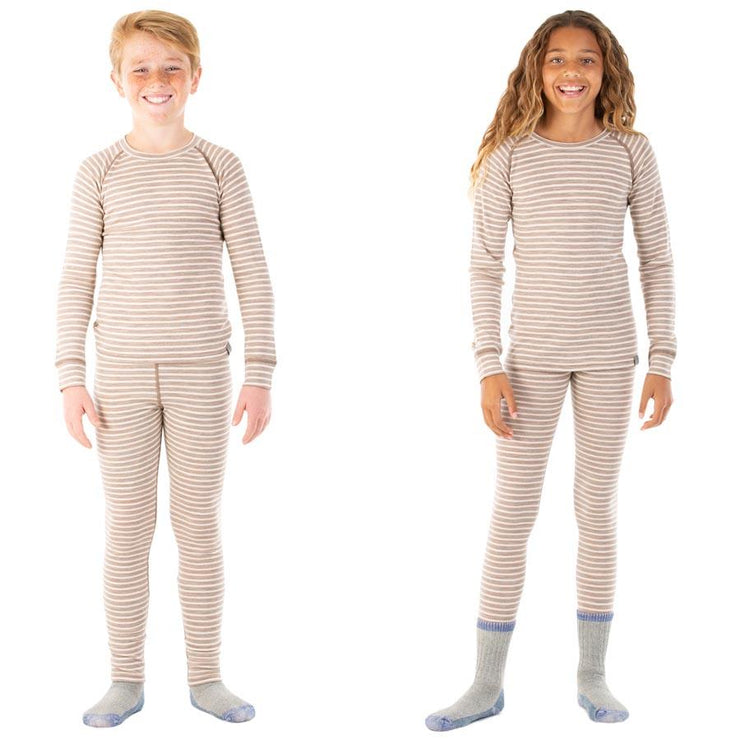 boy and a girl wearing camel stripe colored merino wool kids 250 base layer bottoms