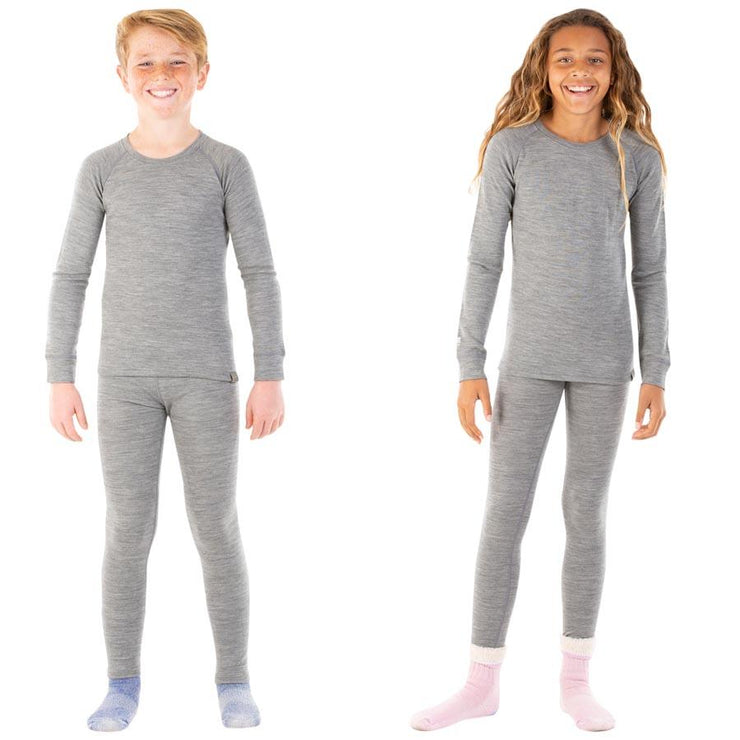 boy and a girl wearing gray heather merino wool kids 250 base layer bottoms