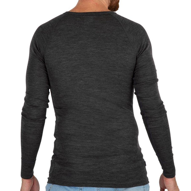 the back of a man wearing a merino wool lightweight basel ayer top