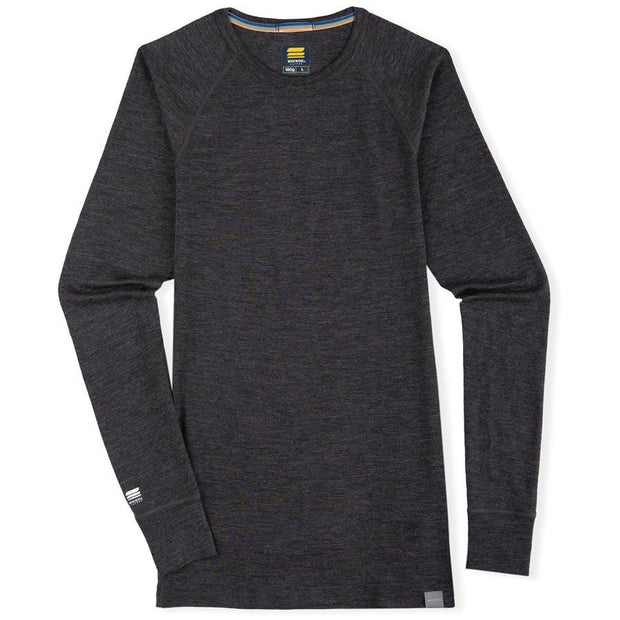 a merino wool lightweight base layer thermal top laying flat on a table