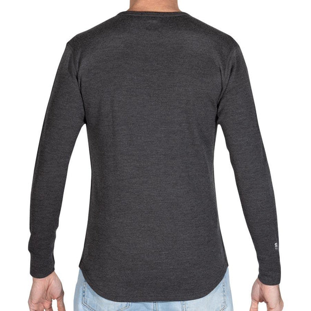 back of a man wearing mens merino wool 400g top crew long sleeve shirt in charcoal gray
