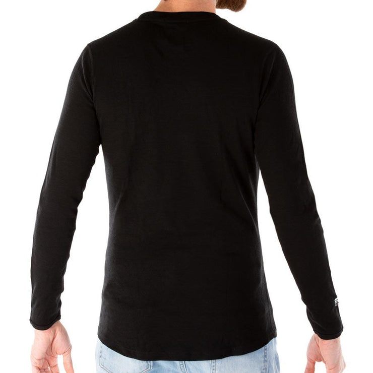 back of a man wearing mens black merino wool base layer long sleeve shirt