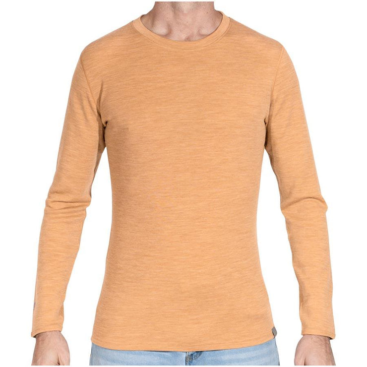 man wearing mens sand merino wool base layer long sleeve shirt