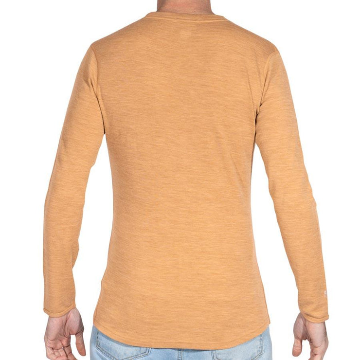 back of a man wearing mens sand merino wool base layer long sleeve shirt