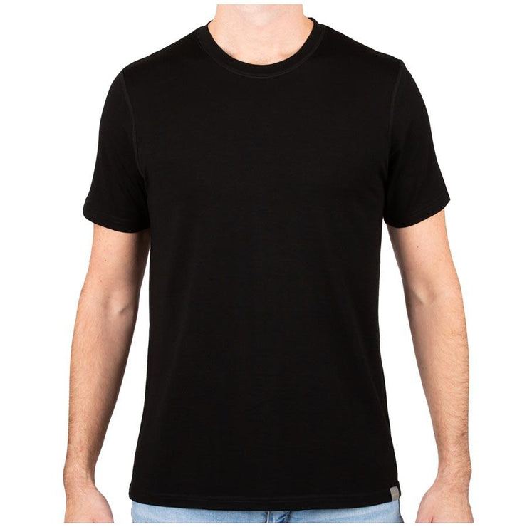 man wearing a black merino wool 190g lightweight t shirt