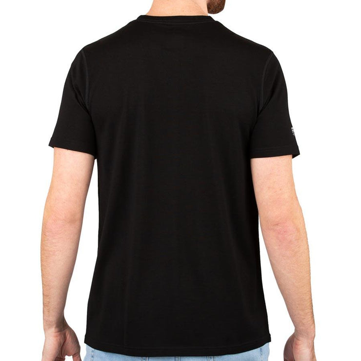 back of a man wearing a black merino wool 190g lightweight t shirt