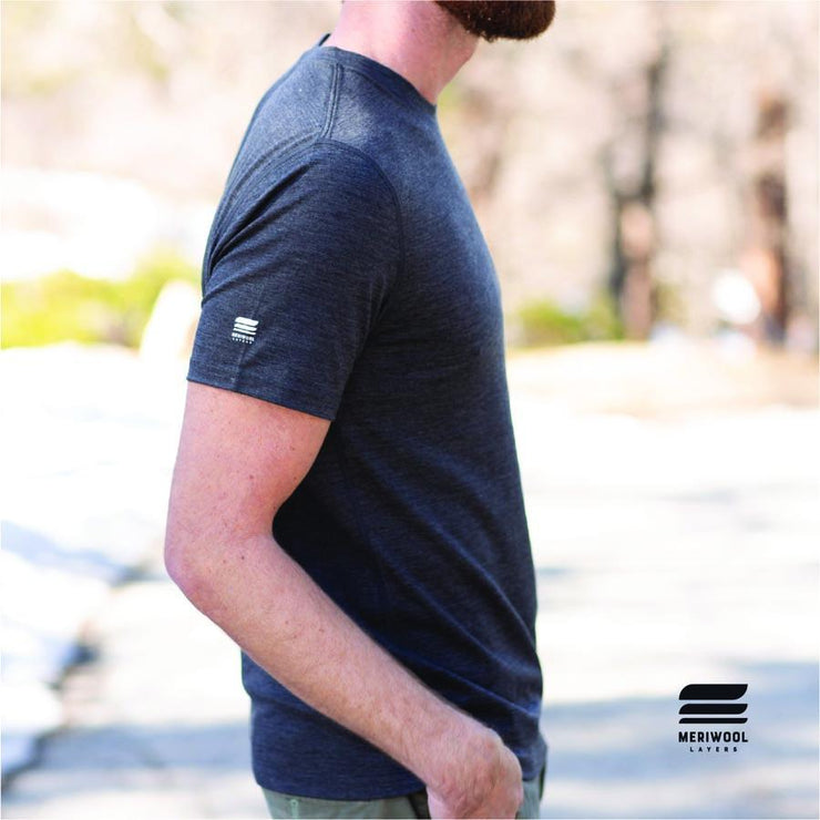 side profile man wearing a charcoal gray merino wool 190g lightweight t shirt outside