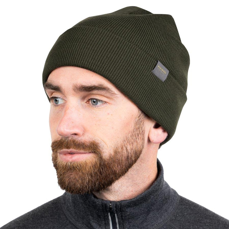 man wearing an army green merino wool ribbed knit beanie