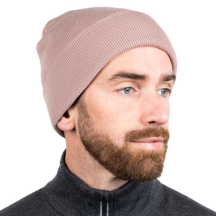 man wearing a beige merino wool ribbed knit beanie