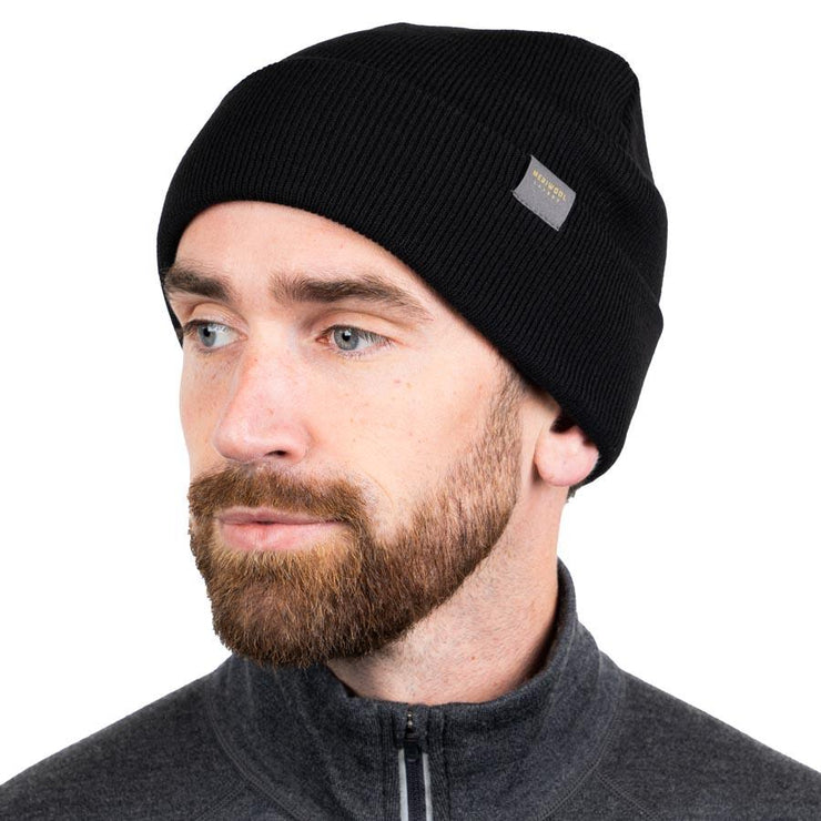 man wearing a black merino wool ribbed knit beanie