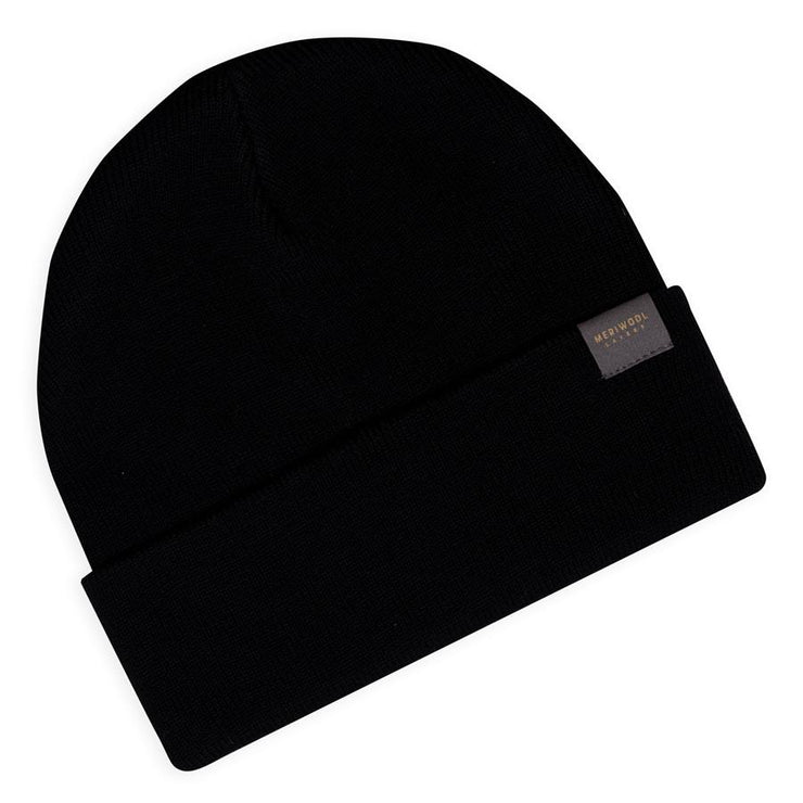 black merino wool ribbed knit beanie laying flat