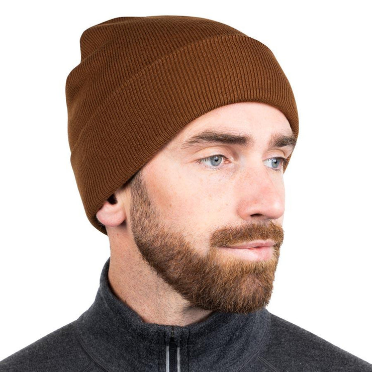 man wearing a brown merino wool ribbed knit beanie