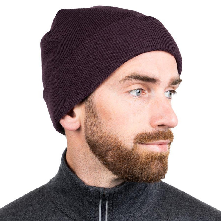 man wearing a berry colored merino wool ribbed knit beanie