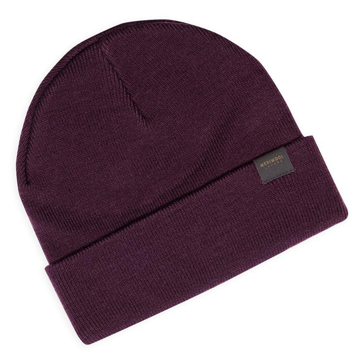 berry colored merino wool ribbed knit beanie laying flat