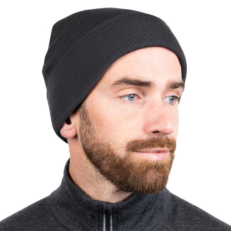 man wearing a charcoal gray merino wool ribbed knit beanie