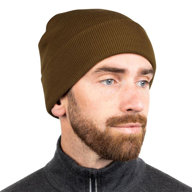 man wearing a coyote colored merino wool ribbed knit beanie