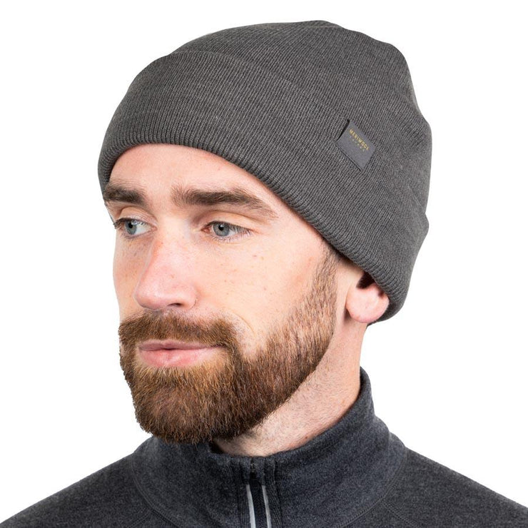 man wearing a gray heather merino wool ribbed knit beanie