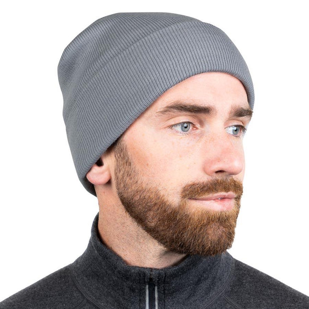 man wearing a light gray merino wool ribbed knit beanie
