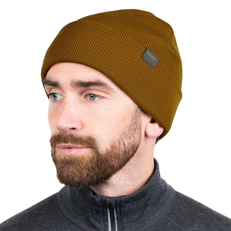 man wearing mustard colored merino wool ribbed knit beanie