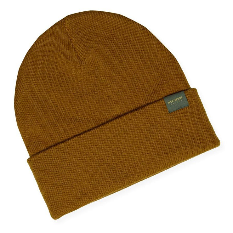 mustard colored merino wool ribbed knit beanie laying flat