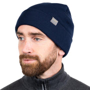 man wearing a navy blue colored merino wool ribbed knit beanie