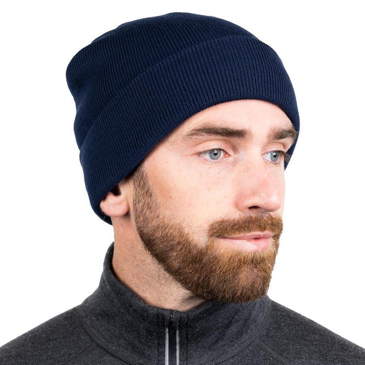 man wearing a navy blue merino wool ribbed knit beanie