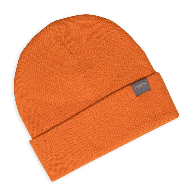 orange merino wool ribbed knit beanie laying flat
