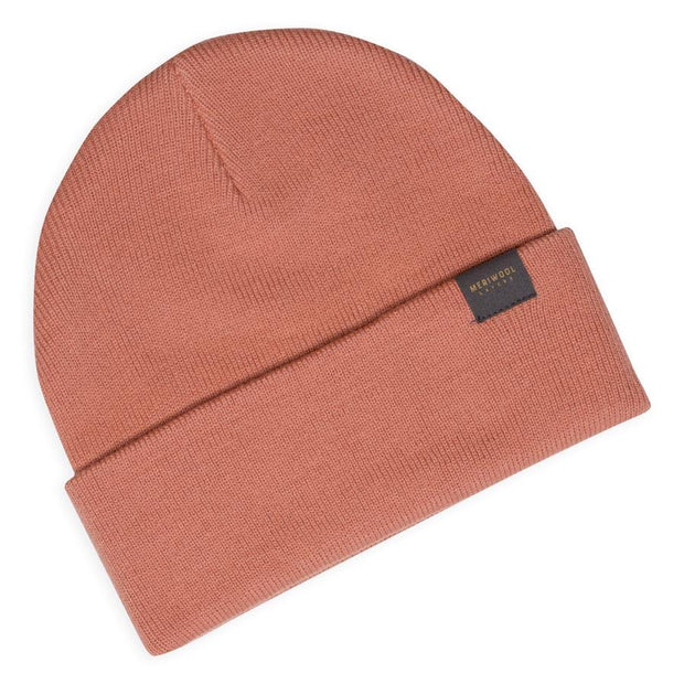 peach colored merino wool ribbed knit beanie laying flat
