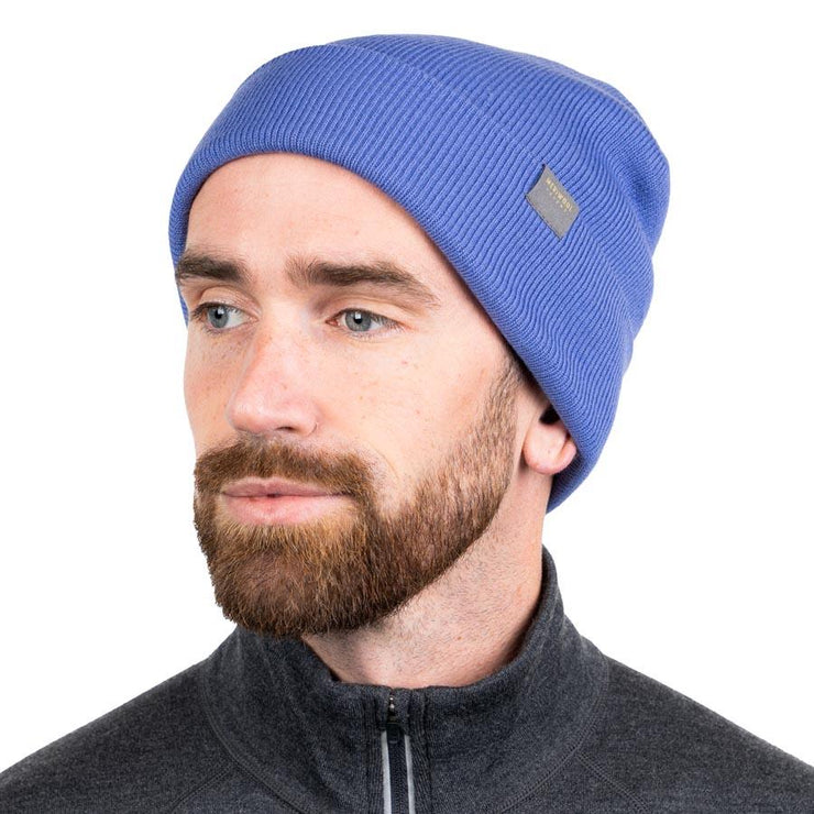 man wearing a periwinkle merino wool ribbed knit beanie